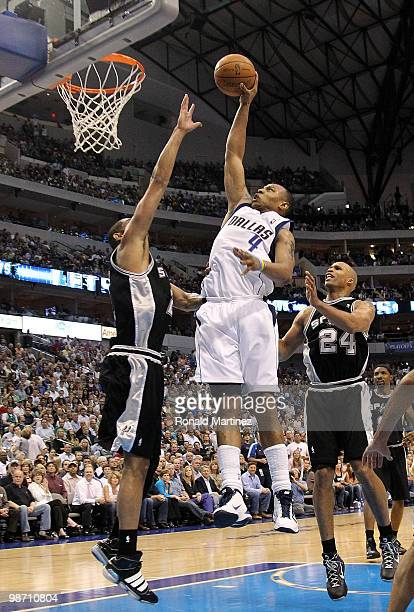 Forward Caron Butler of the Dallas Mavericks drives the hoop against Tim Duncan of the San Antonio Spurs in Game Five of the Western Conference...