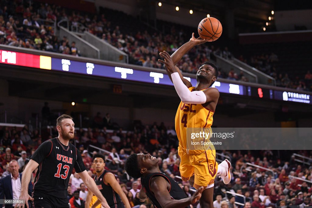 USC forward Chimezie Metu (4) tries to drive to the basket but is fouled by Utah forward Donnie Tillman (3) during a college basketball game between the Utah Utes and the USC Trojans on January 14, 2018, at the Galen Center in Los Angeles, CA.
