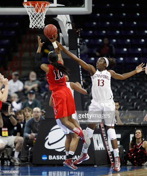 Forward Chiney Ogwumike of the Stanford Cardinal defends while guard Jasmine James of the Georgia Lady Bulldogs makes a goal attempt during the NCAA...