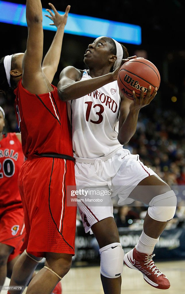 Forward Chiney Ogwumike #13 of the Stanford Cardinal looks to shoot against forward Jasmine Hassell #12 of the Georgia Lady Bulldogs in the second half during the NCAA Division I Women's Basketball Regional Championship at Spokane Arena on March 30, 2013 in Spokane, Washington. The Lady Bulldogs defeated the Cardinal 61-59.