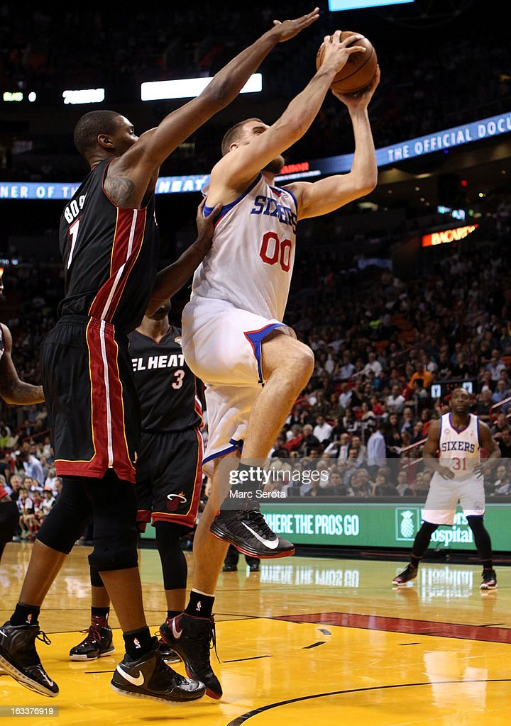 Forward Chris Bosh #1 of the Miami Heat defends against Forward Spencer hawes #00 of the Philadelphia 76ers at American Airlines Arena on March 8, 2013 in Miami, Florida.