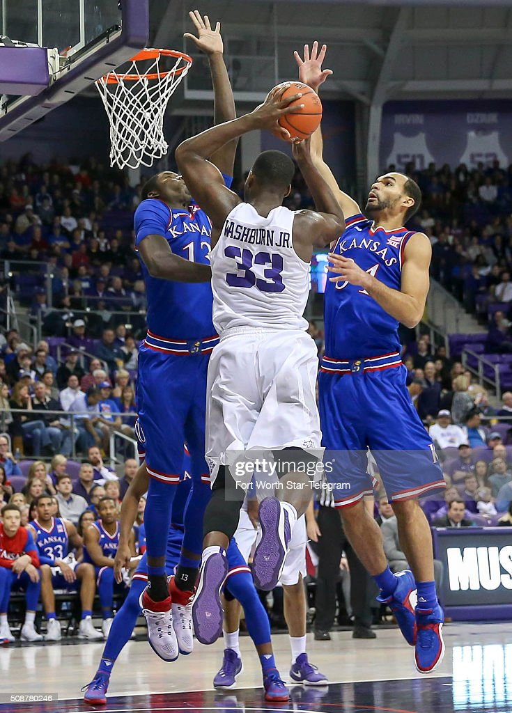 TCU forward Chris Washburn (33) goes strong to the basket against Kansas forward Cheick Diallo (13) and forward Perry Ellis, right, during the first half on Saturday, Feb. 6, 2016, at Schollmaier Arena in Fort Worth, Texas.