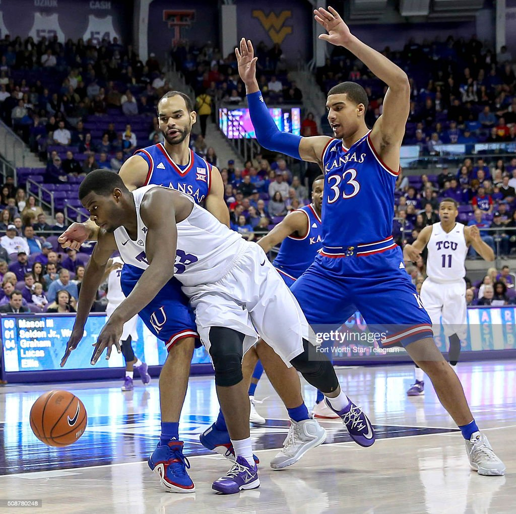 TCU forward Chris Washburn tries to go around Kansas forward Perry Ellis and Landen Lucas (33) during the first half on Saturday, Feb. 6, 2016, at Schollmaier Arena in Fort Worth, Texas.