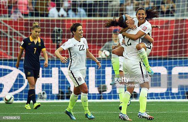 Forward Christen Press celebrates with teammates after scoring a goal during the Group D match of the 2015 FIFA Women's World Cup between the USA and...