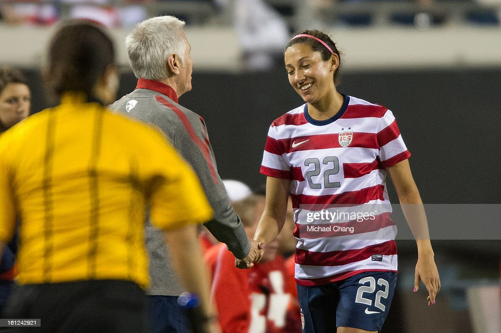 Forward Christen Press #22 of the United States shakes hands with Head coach <a gi-track='captionPersonalityLinkClicked' href=/galleries/search?phrase=Tom+Sermanni&family=editorial&specificpeople=776870 ng-click='$event.stopPropagation()'>Tom Sermanni</a> of the United States during the game against Scotland at EverBank Field on February 9, 2013 in Jacksonville, Florida. The United States defeated Scotland 4-1.
