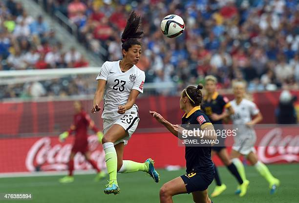Forward Christen Press of the USA heads the ball during the Group D match of the 2015 FIFA Women's World Cup between the US and Australia at the...