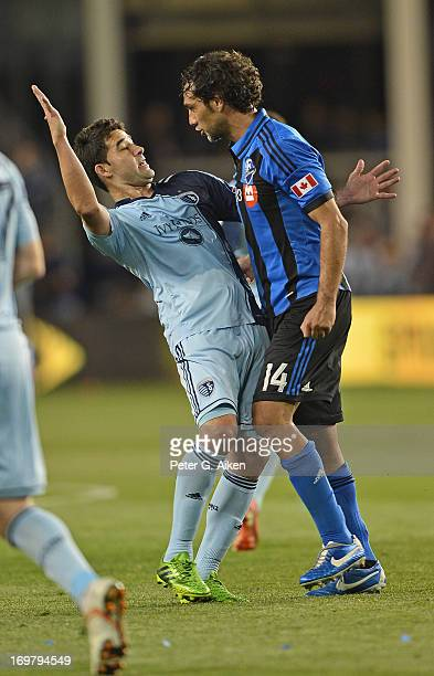 Forward Claudio Bieler of Sporting Kansas City reacts after getting head butted by defender Alessandro Nesta of the Montreal Impact during the second...
