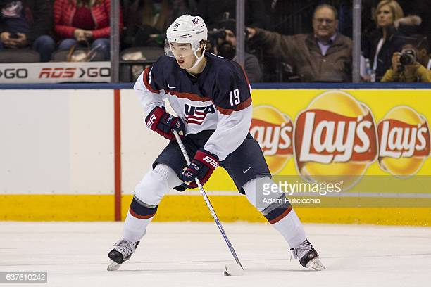 Forward Clayton Keller of Team United States sets up a play in the defensive zone against Team Slovakia in a preliminary round Group B game during...