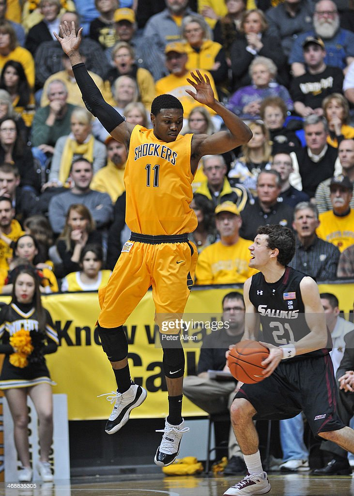 Forward <a gi-track='captionPersonalityLinkClicked' href=/galleries/search?phrase=Cleanthony+Early&family=editorial&specificpeople=10064686 ng-click='$event.stopPropagation()'>Cleanthony Early</a> #11 of the Wichita State Shockers defends against guard Tyler Smithpeters #21 of the Southern Illinois Salukis during the second half on February 11, 2014 at Charles Koch Arena in Wichita, Kansas. Wichita State won 78-67.