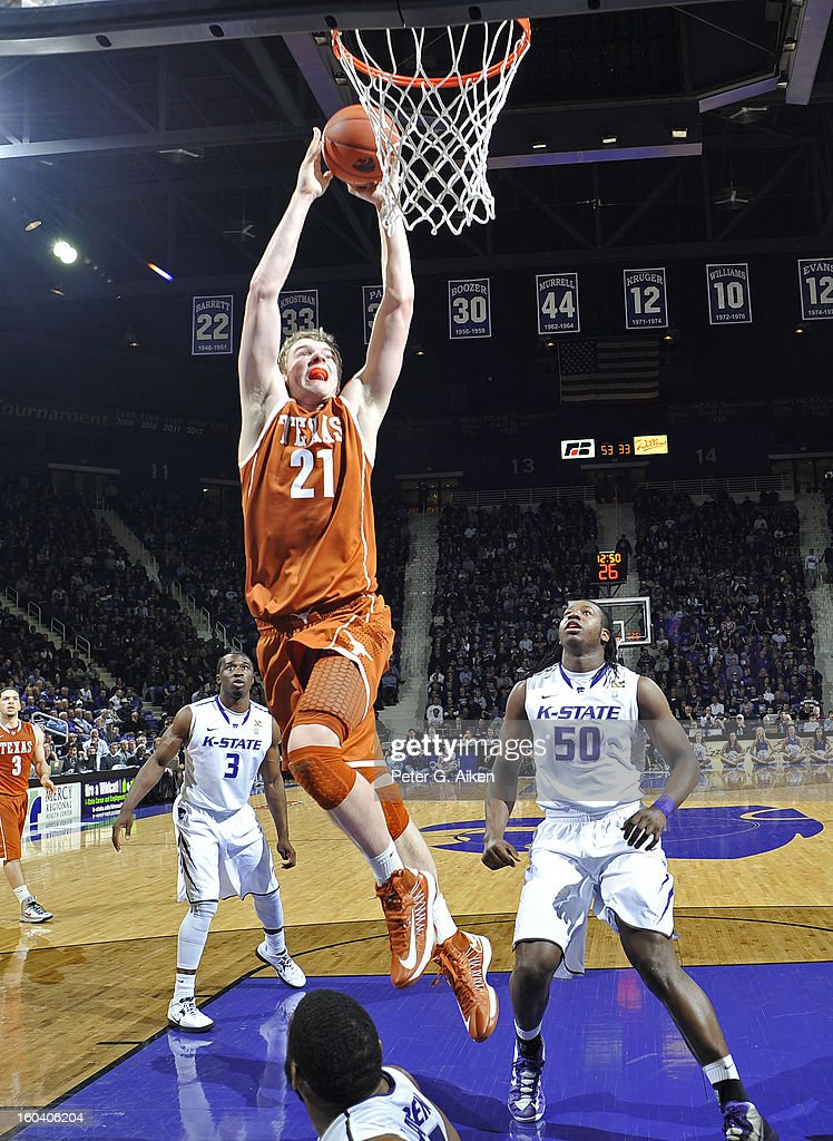 Forward Connor Lammert #21 of the Texas Longhorns drives to the basket past forward D.J. Johnson #50 of the Kansas State Wildcats during the second half on January 30, 2013 at Bramlage Coliseum in Manhattan, Kansas. Kansas State defeated Texas 83-57.