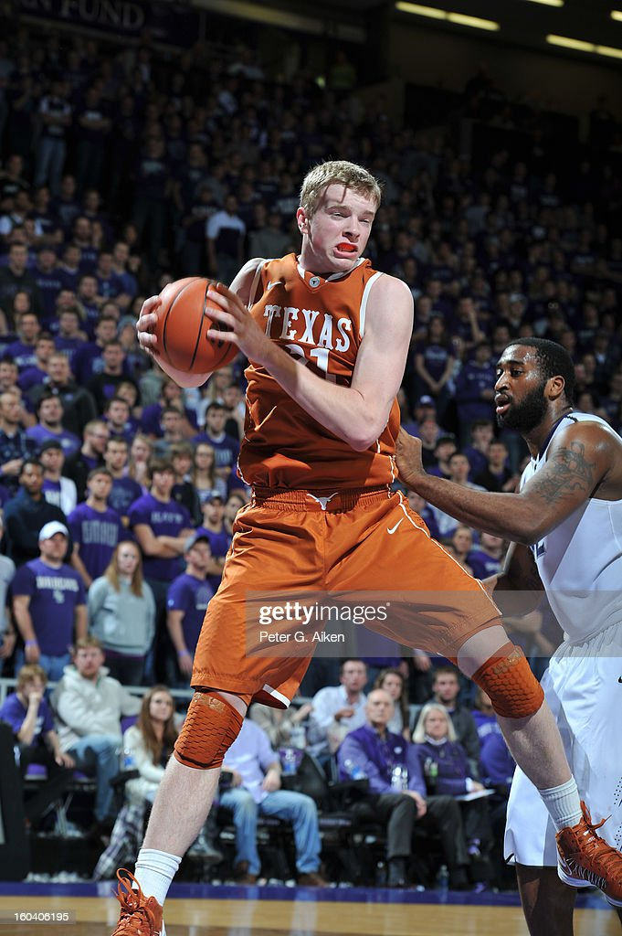 Forward Connor Lammert #21 of the Texas Longhorns pulls down a defensive rebound against the Kansas State Wildcats during the second half on January 30, 2013 at Bramlage Coliseum in Manhattan, Kansas. Kansas State defeated Texas 83-57.
