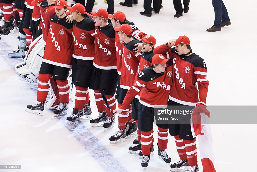 Forward Connor McDavid and Defenseman Samuel Morin of Canada celebrate the 54 win against Russia during the Gold medal game of the 2015 IIHF World...