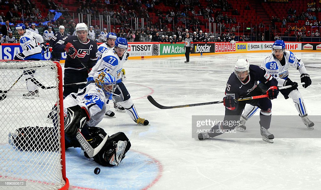 US forward Craig Smith (2R) scores the first goal past the Finland's goalkeeper Antti Raanta during the third place match Finland vs United States of the IIHF International Ice Hockey World Championship at Globe Arena in Stockholm on May 19, 2013. AFP PHOTO / ANDREJ ISAKOVIC RESTRICTED TO EDITORIAL USE