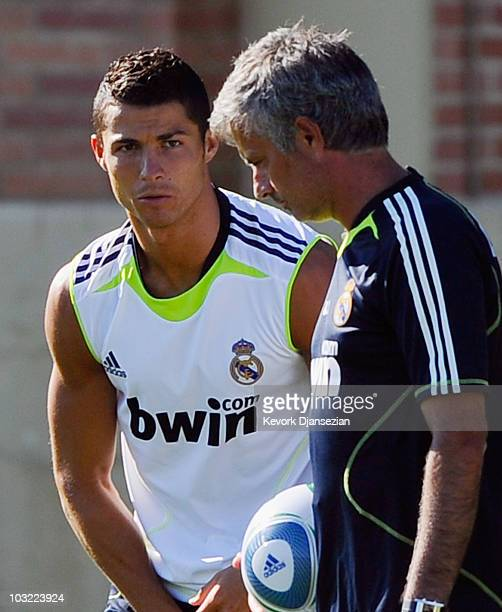 Forward Cristiano Ronaldo of Real Madrid looks at coach Jose Mourinho during a training session on the campus of UCLA on August 3 2010 in Los Angeles...
