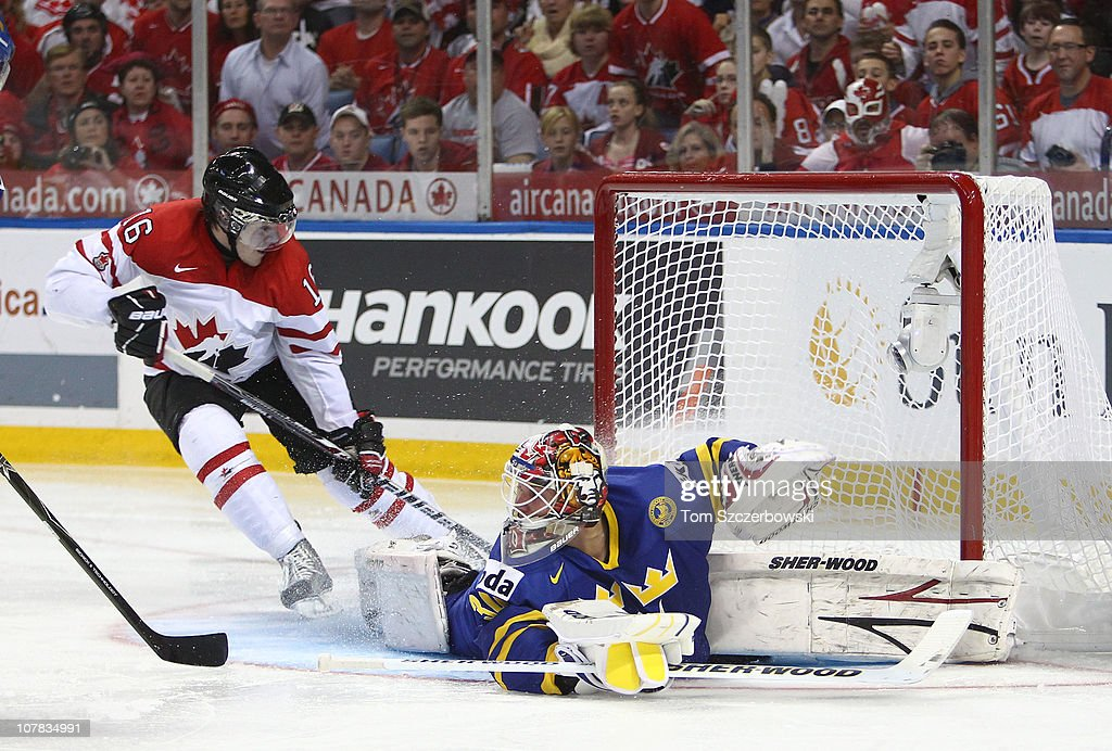 Forward Curtis Hamilton #16 of Canada scores past goalie Robin Lehner #30 of Sweden during the 2011 IIHF World U20 Championship game between Canada and Sweden on December 31, 2010 at HSBC Arena in Buffalo, New York.