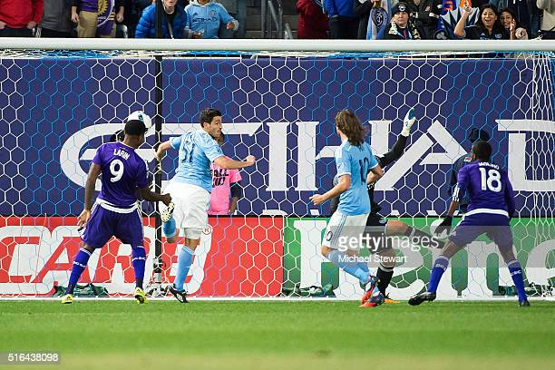 Forward Cyle Larin of Orlando City SC scores a goal during the Orlando City SC vs New York City FC match at Yankee Stadium on March 18 2016 in the...