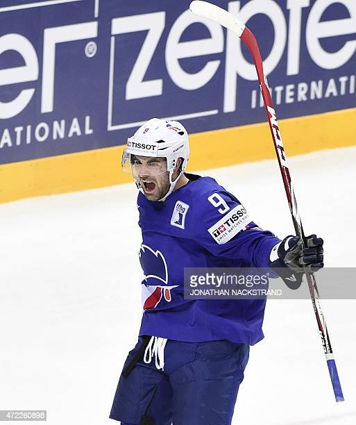 Forward Damien Fleury of France celebrates after scoring a goal during the group A preliminary round ice hockey match Austria vs France of the IIHF...