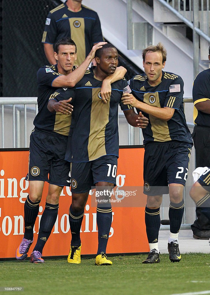 Forward Danny Mwanga of the Philadelphia Union is congratulated by forward Sebatien Le Toux and midfielder Justin Mapp after scoring a goal during a...