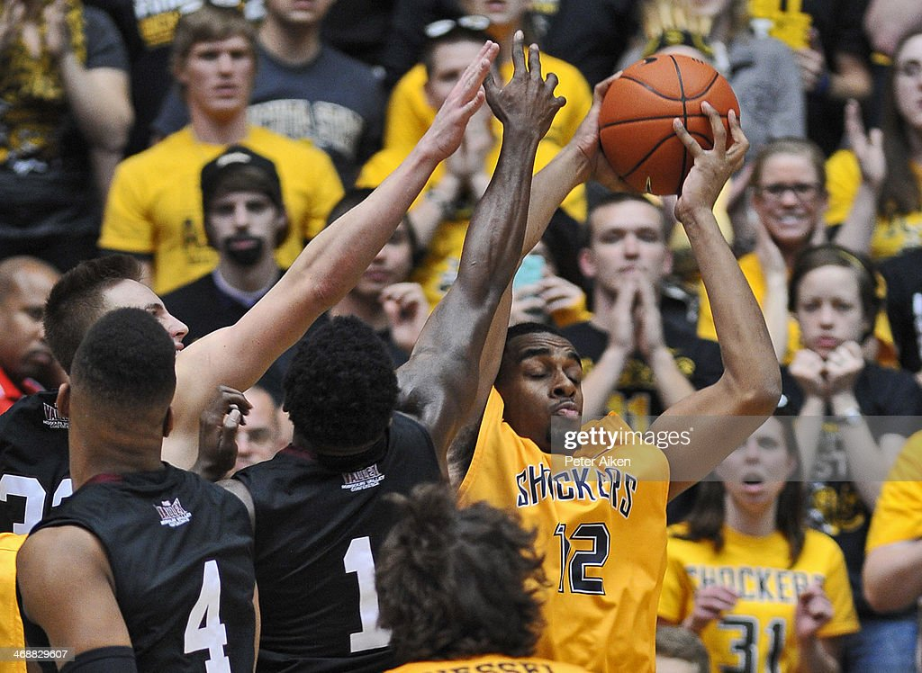 Forward Darius Carter #12 of the Wichita State Shockers grabs a rebound against guard Jalen Pendleton #1 of the Southern Illinois Salukis during the second half on February 11, 2014 at Charles Koch Arena in Wichita, Kansas. Wichita State won 78-67.