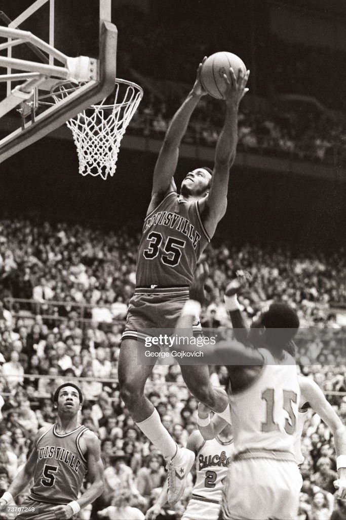 Forward Darrell Griffith of the Louisville Cardinals dunks during a college basketball game against the Ohio State Buckeyes at St John Arena circa...