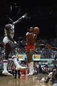 Forward Darrell Griffith of the University of Louisville Cardinals looks to pass during a college basketball game against the Ohio State Buckeyes at...