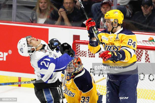Forward Darren Raddysh of the Erie Otters delivers a stick to the face of forward Mathieu Joseph of the Saint John Sea Dogs on May 26 2017 during the...