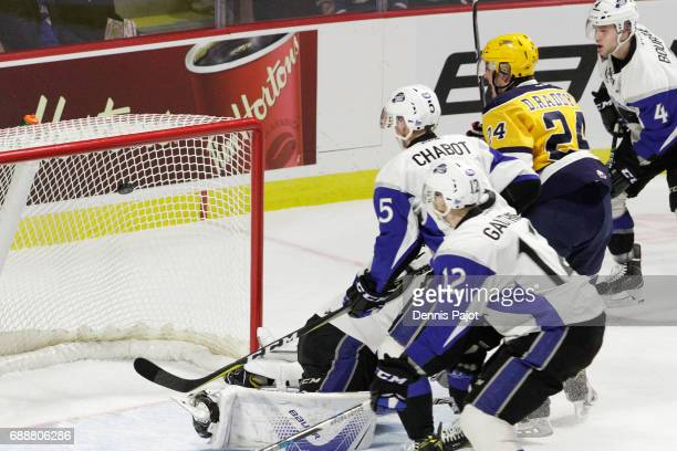 Forward Darren Raddysh of the Erie Otters watches his first period goal fall into the net against goaltender Callum Booth of the Saint John Sea Dogs...