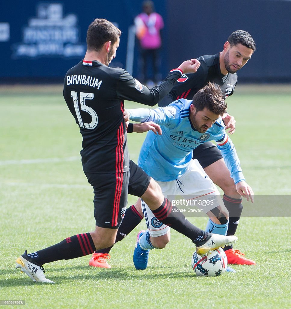 Forward David Villa #7 of New York City FC and defender Steve Birnbaum #15 of D.C. United vie for the ball during the match at Yankee Stadium on March 12, 2017 in the Bronx borough of New York City. New York City FC deafeats D.C. United 4-0.