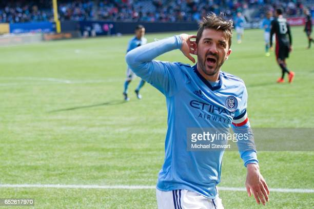 Forward David Villa of New York City FC celebrates after scoring a goal during the match against DC United at Yankee Stadium on March 12 2017 in the...