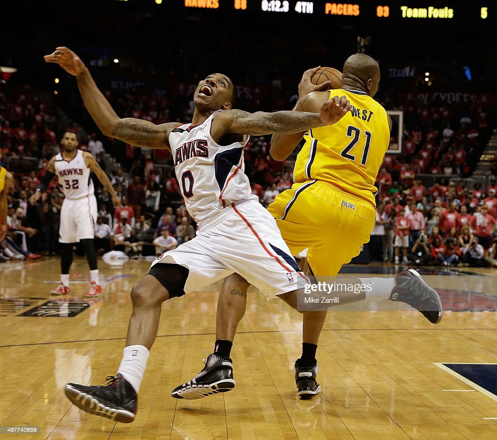 Forward David West of the Indiana Pacers grabs the ball behind guard Jeff Teague of the Atlanta Hawks in Game 6 of the Eastern Conference...