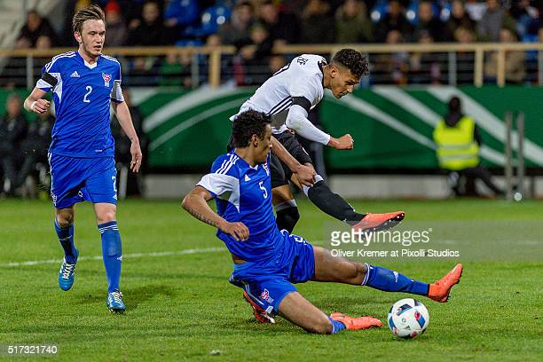 Forward Davie Selke of Germany trying to score while Sonni Ragnar Nattestad of Faroe Islands try to the defend the ball at Frankfurter...