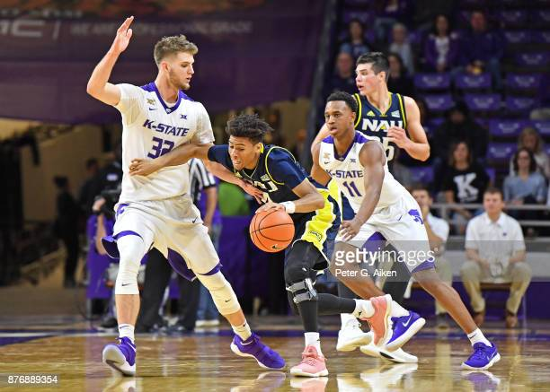 Forward Dean Wade of the Kansas State Wildcats defends guard JoJo Anderson of the Northern Arizona Lumberjacks during the second half on November 20...