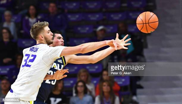 Forward Dean Wade of the Kansas State Wildcats deflects the ball away from forward Brooks Debisschop of the Northern Arizona Lumberjacks during the...