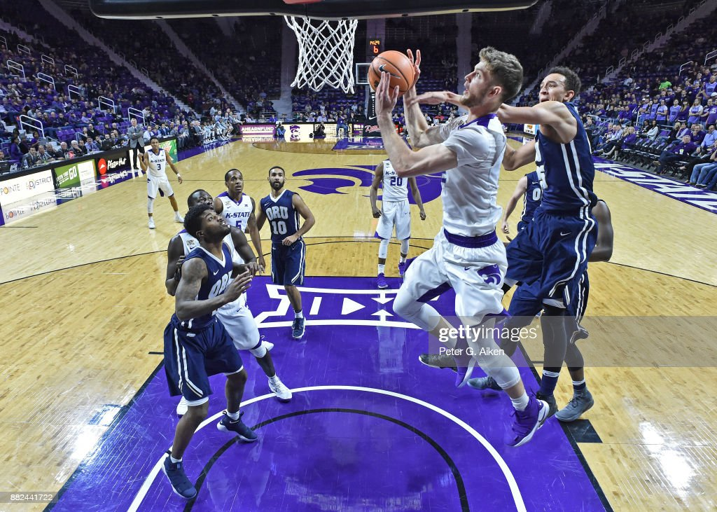 Forward Dean Wade #32 of the Kansas State Wildcats drives to the basket around pressure from forward Javan White #25 of the Oral Roberts Golden Eagles during the first half on November 29, 2017 at Bramlage Coliseum in Manhattan, Kansas.