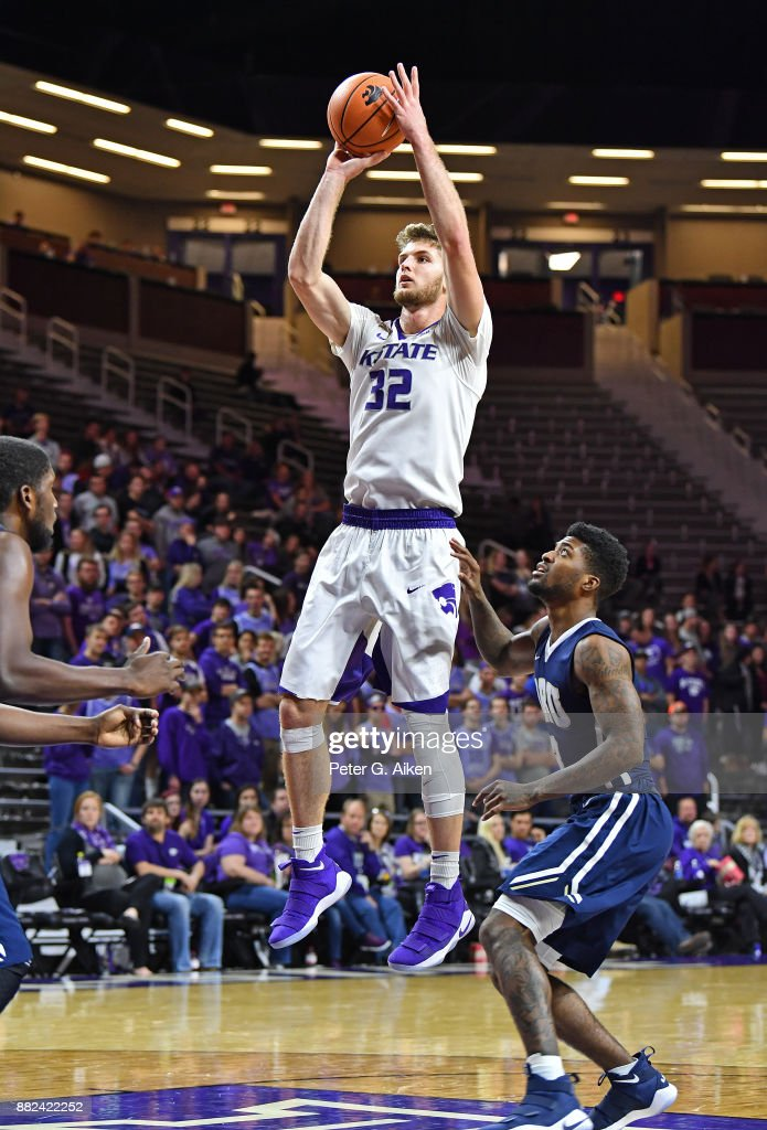 Forward Dean Wade #32 of the Kansas State Wildcats hits a shot over guard Jontray Harris #3 of the Oral Roberts Golden Eagles during the second half on November 29, 2017 at Bramlage Coliseum in Manhattan, Kansas.