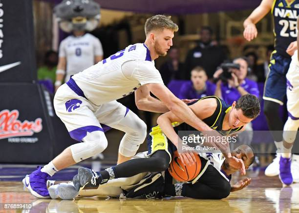 Forward Dean Wade of the Kansas State Wildcats reaches in for the ball against guard Chris Bowling of the Northern Arizona Lumberjacks during the...