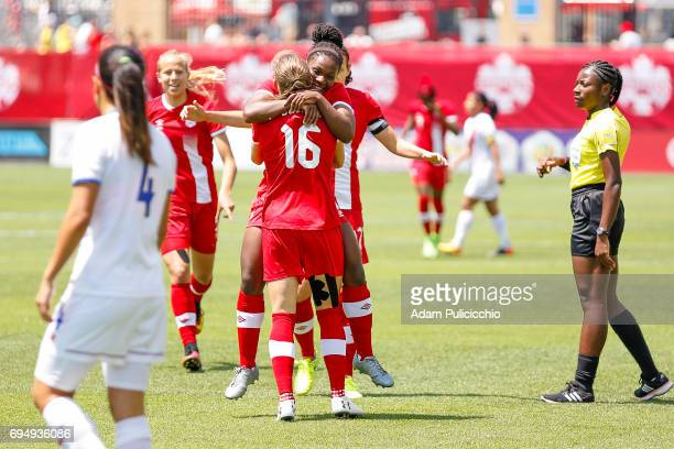 Forward Deanne Rose of Team Canada jumps and hugs teammate Forward Janine Beckie after a goal against Team Costa Rica during the first half in a...