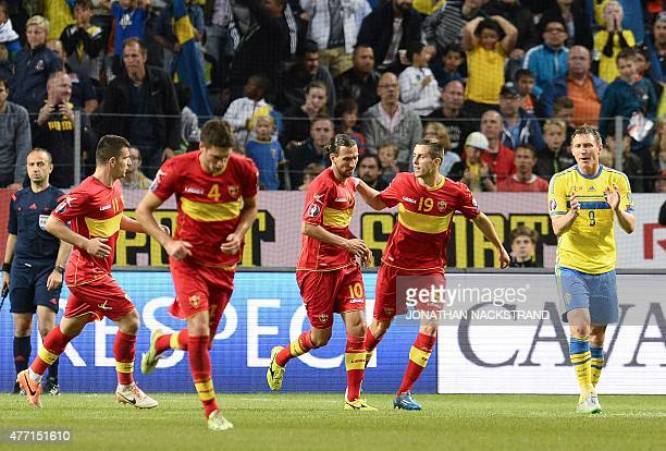 Forward Dejan Damjanovic of Montenegro celebrates with his teammates after scoring a goal during the Euro qualifying football match between Sweden...