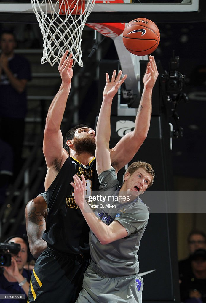 Forward Deniz Kilicli #13 of the West Virginia Mountaineers reaches for the ball against guard Will Spradling #55 of the Kansas State Wildcats during the second half on February 18, 2013 at Bramlage Coliseum in Manhattan, Kansas. Kansas State defeated West Virginia 71-61.