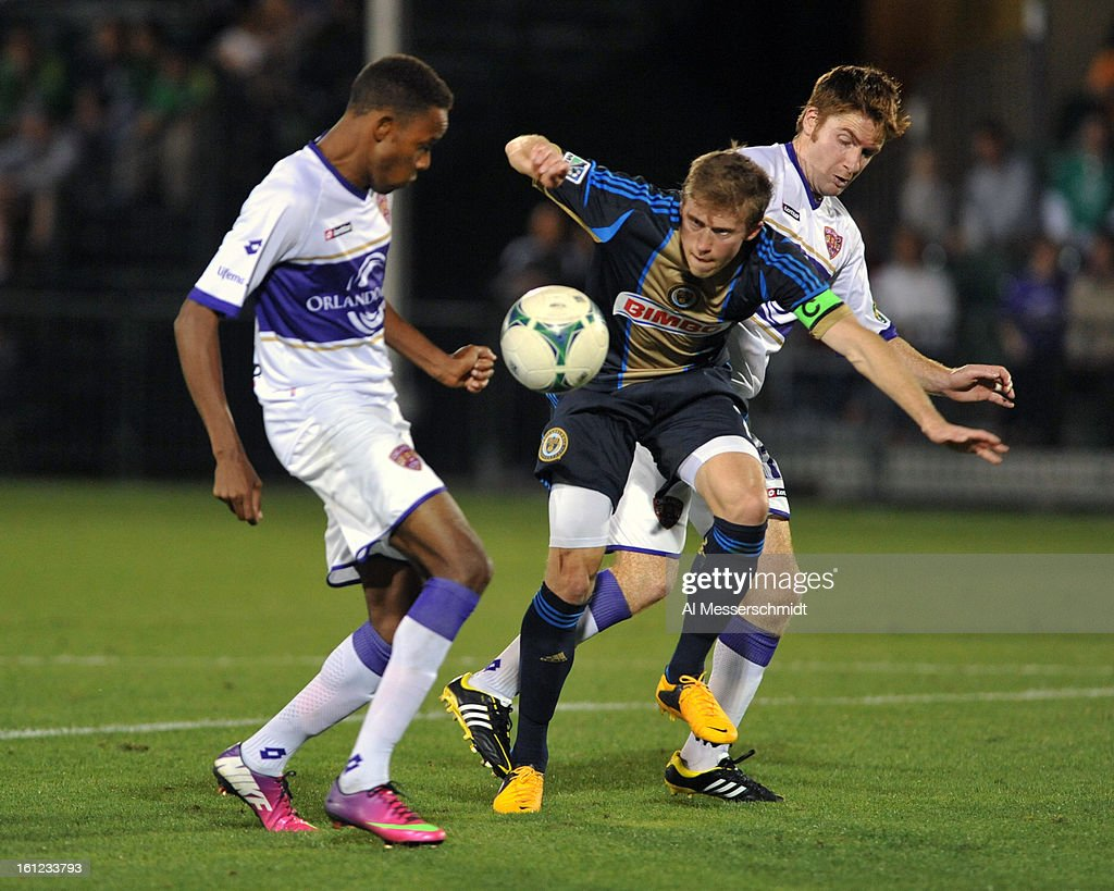 Forward Dennis Chin #15 of Orlando City battles midfielder <a gi-track='captionPersonalityLinkClicked' href=/galleries/search?phrase=Brian+Carroll&family=editorial&specificpeople=630651 ng-click='$event.stopPropagation()'>Brian Carroll</a> #7 of the Philadelphia Union February 9, 2013 in the first round of the Disney Pro Soccer Classic in Orlando, Florida. The match ended in a 1 - 1 tie.