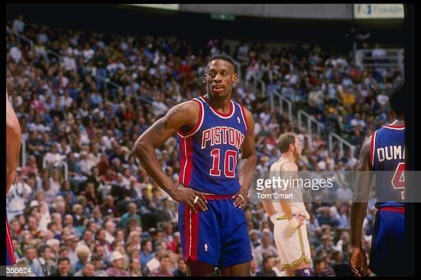 Forward Dennis Rodman of the Detroit Pistons looks on during a game against the Utah Jazz at the Delta Center in Salt Lake City Utah