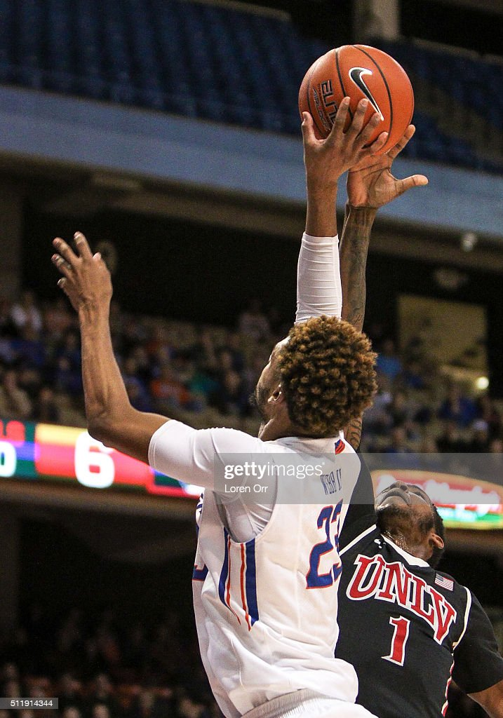 Forward Derrick Jones Jr #1 of the UNLV Rebels blocks the shot of forward James Webb III of the Boise State Broncos during first half action on...