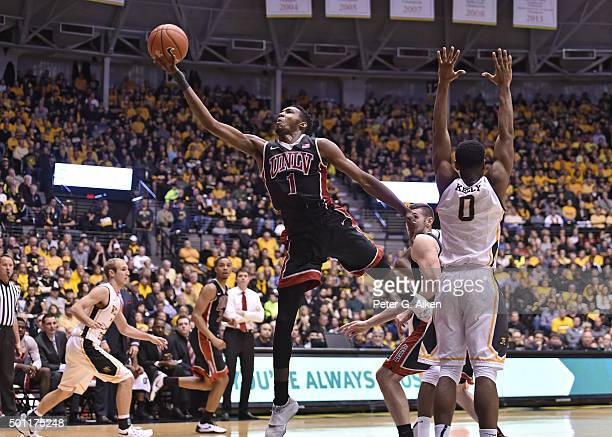 Forward Derrick Jones Jr #1 of the UNLV Rebels drives to the basket past forward Rashard Kelly of the Wichita State Shockers during the second half...