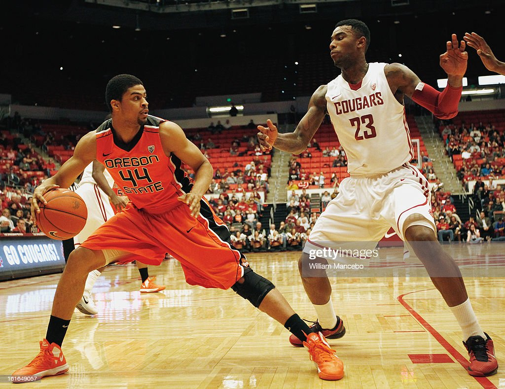 Forward Devon Collier #44 of the Oregon State Beavers plays against forward D.J. Shelton #23 of the Washington State Cougars during the second half of the game at Beasley Coliseum on February 13, 2013 in Pullman, Washington.