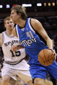 Forward Dirk Nowitzki of the Dallas Mavericks dribbles the ball past Matt Bonner of the San Antonio Spurs in Game Three of the Western Conference...