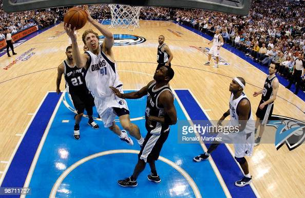 Forward Dirk Nowitzki of the Dallas Mavericks takes a shot against Antonio McDyess of the San Antonio Spurs in Game Five of the Western Conference...