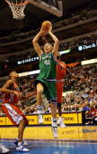 Forward Dirk Nowitzki the Dallas Mavericks goes to the hoop against Antawn Jamison of the Washington Wizards on January 18 2005 at the American...