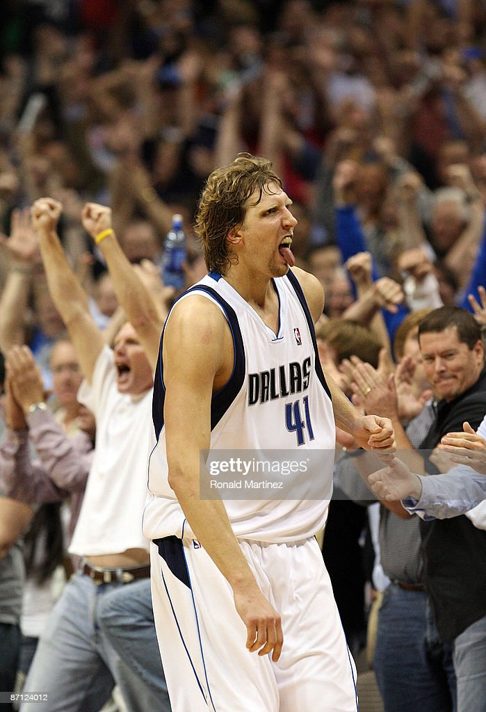 Forward Dirk Nowtizki #41 of the Dallas Mavericks reacts after scoring to take a two-point lead against the Denver Nuggets in Game Four of the Western Conference Semifinals during the 2009 NBA Playoffs at American Airlines Center on May 11, 2009 in Dallas, Texas.
