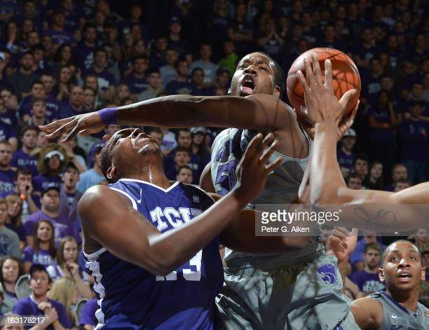 Forward DJ Johnson of the Kansas State Wildcats fouls forward Devonta Abron of the Texas Christian Horned Frogs during the first half on March 5 2013...