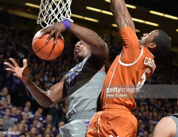 Forward DJ Johnson of the Kansas State Wildcats grabs a rebound against guard Damarcus Crocker of the Texas Longhorns during the second half on...